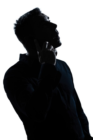 one caucasian man  telephone surprised portrait silhouette in studio isolated white background Stock Photo - 11753072