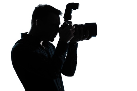 one caucasian man portrait silhouette photographer in studio isolated on white background photo