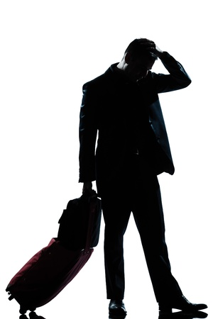 one caucasian man full length silhouette in studio isolated white background photo