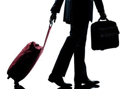business traveler: detail side view one caucasian business traveler man walking with suitcase  full length silhouette in studio isolated white background