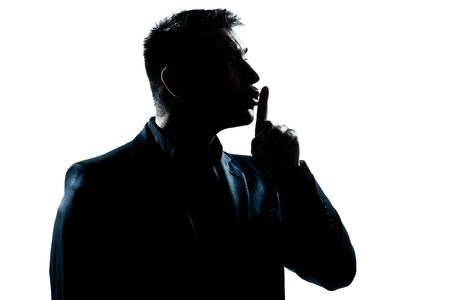 quiet adult: one caucasian man hushing profile portrait silhouette in studio isolated white background