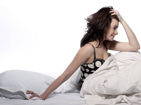 young woman in a white sheet bed on white background Stock Photo - 11752872