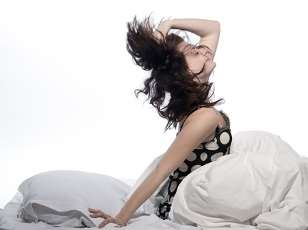 young woman in a white sheet bed on white background Stock Photo - 11752933