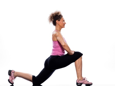 supple: beautiful mature woman on isolated white background doing stretching exercise