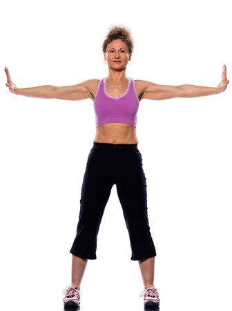 beautiful mature woman on isolated white background doing stretching exercise photo