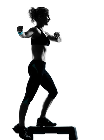 one adult: one woman exercising workout fitness aerobic exercise posture on studio isolated white background