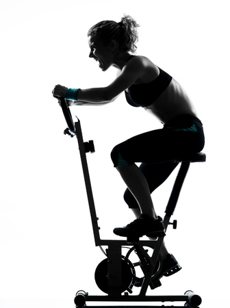 one woman biking exercising workout fitness aerobic exercise posture on studio isolated white background photo