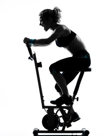 one woman biking exercising workout fitness aerobic exercise posture on studio isolated white background