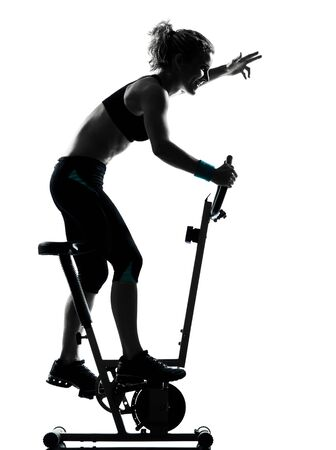 one woman biking exercising workout fitness aerobic exercise posture on studio isolated white background photo