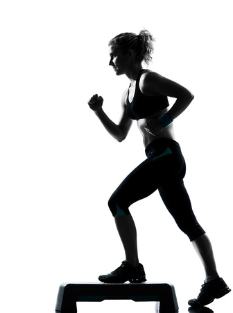 step fitness: one woman exercising workout fitness aerobic exercise posture on studio isolated white background