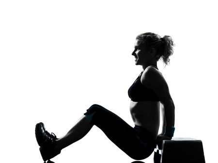 step fitness: one woman exercising workout fitness aerobic exercise abdominals push ups posture on studio isolated white background Stock Photo
