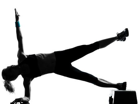 one woman exercising workout fitness aerobic exercise abdominals push ups posture on studio isolated white background photo