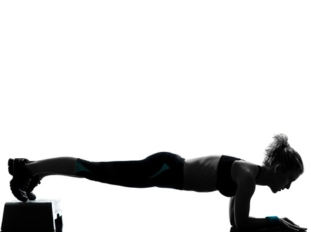 one woman exercising step aerobics  workout fitness aerobic exercise abdominals push ups posture on studio isolated white background photo