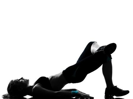 isol� sur fond blanc: une femme exer�ant entra�nement de fitness posture exercice a�robie en studio isol� sur fond blanc