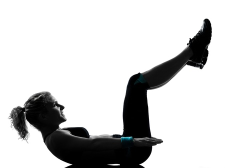 one woman exercising workout fitness aerobic exercise abdominals push ups posture on studio isolated white background Stock Photo - 11753071