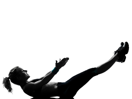 one woman exercising workout fitness aerobic exercise abdominals push ups lying on back posture on studio isolated white background photo