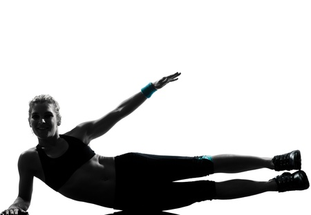 one woman exercising workout fitness aerobic exercise abdominals push ups posture on studio isolated white background Stock Photo - 11753036