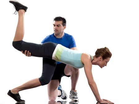 one caucasian couple man aerobic trainer positioning woman  Workout coach Posture in indoors studio isolated on white background photo