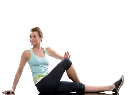 knee bend: woman on Abdominals rotation workout posture on white background. Sit up, straighten one leg and bend the other one. Hold the knee and bring it towards you for 10-20 seconds. Release and switch.