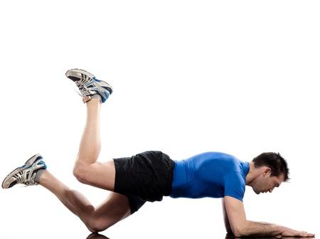 man on Abdominals workout posture on white background. Plank Bent Leg Raise photo