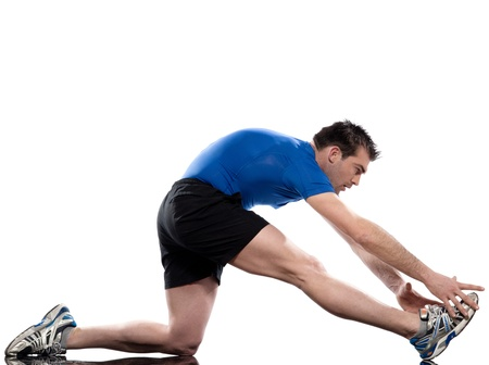 stretching workout posture by a man on studio white background photo