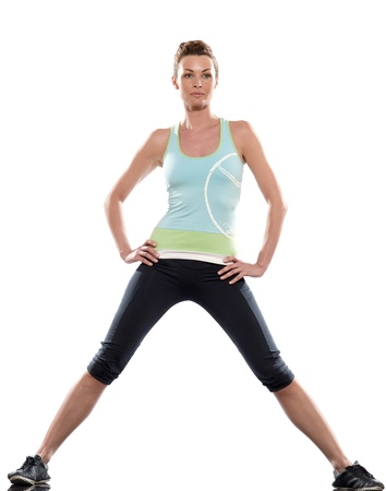 girl in sportswear: stretching workout posture by a woman on studio white background Stock Photo