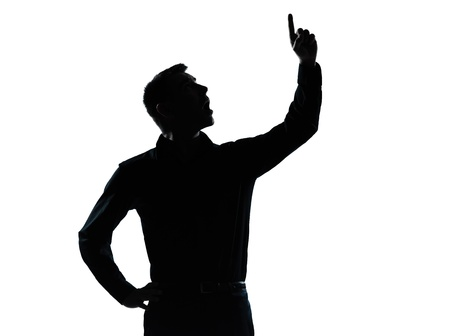 man pointing up: one caucasian business man pointing up surprised  portrait silhouette in studio isolated on white background