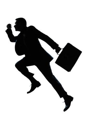 impulse: ein kaukasisch Gesch�ftsmann Springen Silhouette l�uft in voller L�nge im Studio isoliert auf wei�em Hintergrund Lizenzfreie Bilder