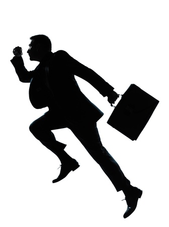 running businessman: one caucasian business man jumping running  silhouette Full length in studio isolated on white background Stock Photo