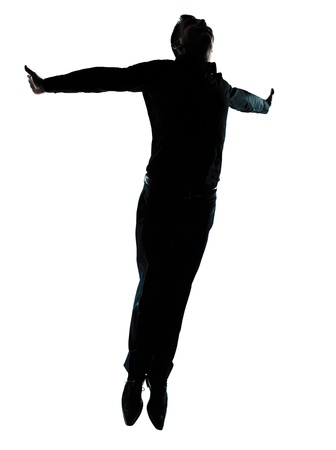 one caucasian business man  jumping flying wellness silhouette Full length in studio isolated on white background photo