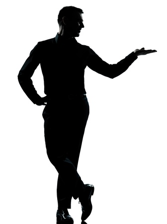 male silhouette: one caucasian business man silhouette standing hand open  Full length in studio isolated on white background