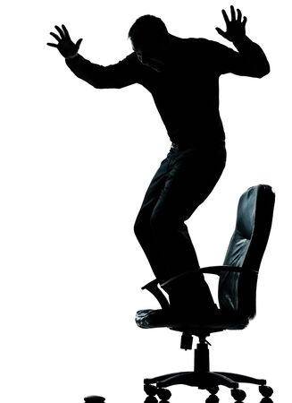 one caucasian business man afraid of computer mouse silhouette Full length in studio isolated on white background photo