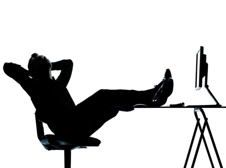 pregui�oso: one caucasian business man computer computing relaxing  silhouette Full length in studio isolated on white background