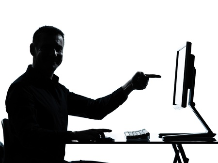 one caucasian business man pointing gesture computer computing silhouette in studio isolated on white background photo