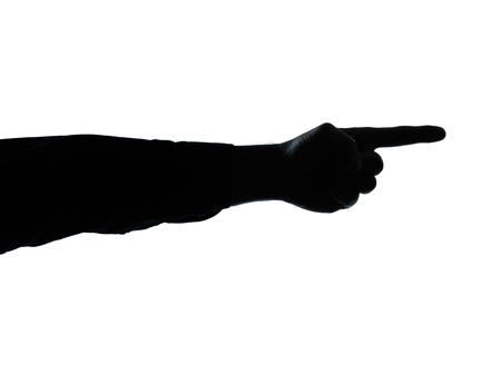 directing: one caucasian close up detail one man hand pointing silhouette in studio isolated on white background Stock Photo