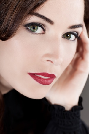 Close-up portrait of a beautiful middle aged woman with beautiful red lips photo