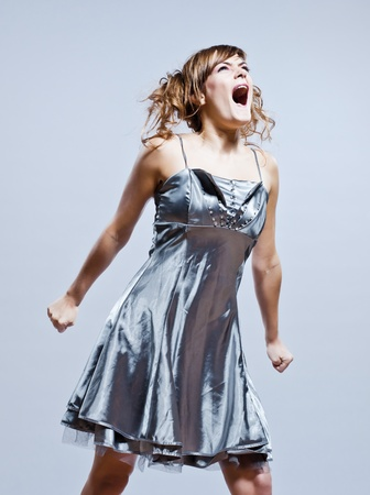 beautiful young caucasian woman girl evening dress screaming angry on studio isolated plain background Stock Photo - 11766221