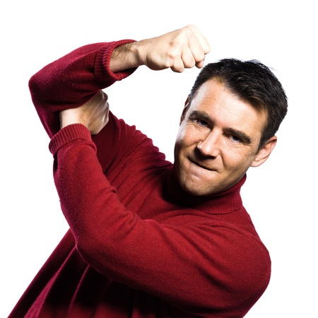 disrespect: caucasian man  anger rude obscene gesture studio portrait on isolated white backgound