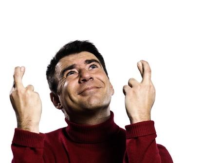 handsign: caucasian man finger crossed gesture studio portrait on isolated white backgound