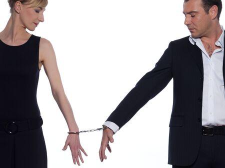 woman handcuffs: beautiful caucasian couple on studio white background Stock Photo