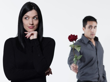 timidity: amn offering a rose to a woman