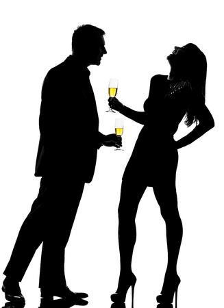people partying: one caucasian couple man and woman drinking flirting partying in studio silhouette isolated on white background