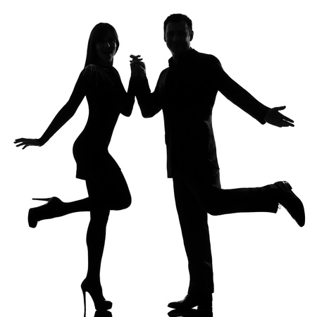 dancing girl: one caucasian couple man and woman dancing rock in studio silhouette isolated on white background