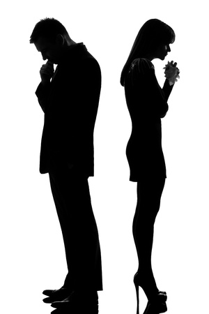 cry: one caucasian sad couple back to back man thinking and woman crying standing back to back man and woman in studio silhouette isolated on white background