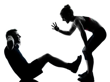 een koppel man vrouw te oefenen workout aërobe fitheid houding volle lengte silouhette op studio geà ¯ soleerd op witte achtergrond Stockfoto