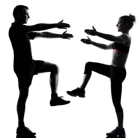one couple man woman exercising workout aerobic fitness posture full length silouhette on studio isolated on white background Stock Photo - 11752620