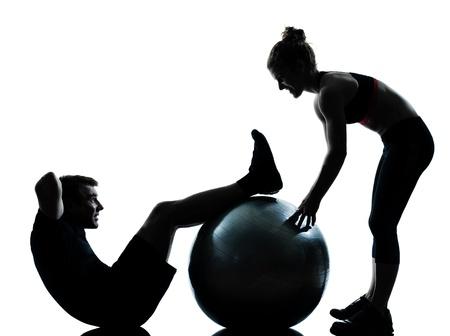 Une femme homme couple exercice d'entraînement aérobique posture longueur silouhette complète en studio isolé sur fond blanc Banque d'images - 11752567