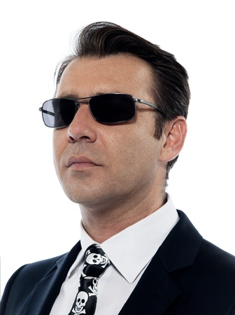 one Man caucasian criminal portrait serious wih sunglasses in studio isolated on white background photo