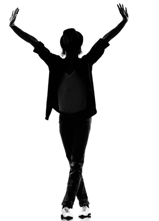 break dancer: full length silhouette of a young man dancer dancing funky hip hop r&b on  isolated  studio white background