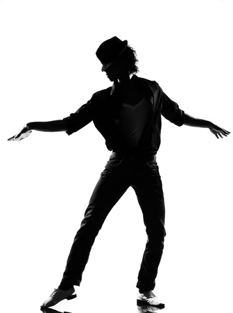 jackson: full length silhouette of a young man dancer dancing funky hip hop r&b on  isolated  studio white background